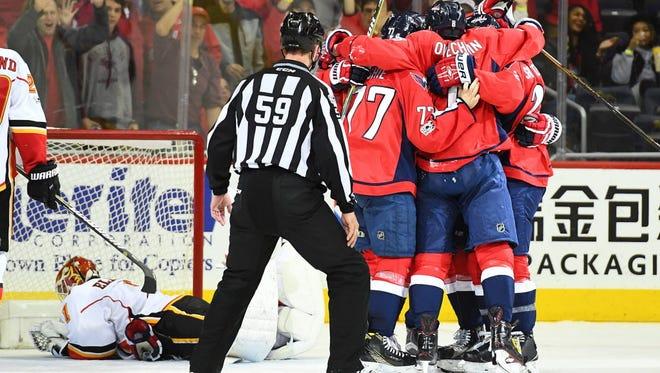 The Washington Capitals celebrate a goal against the Calgary Flames.