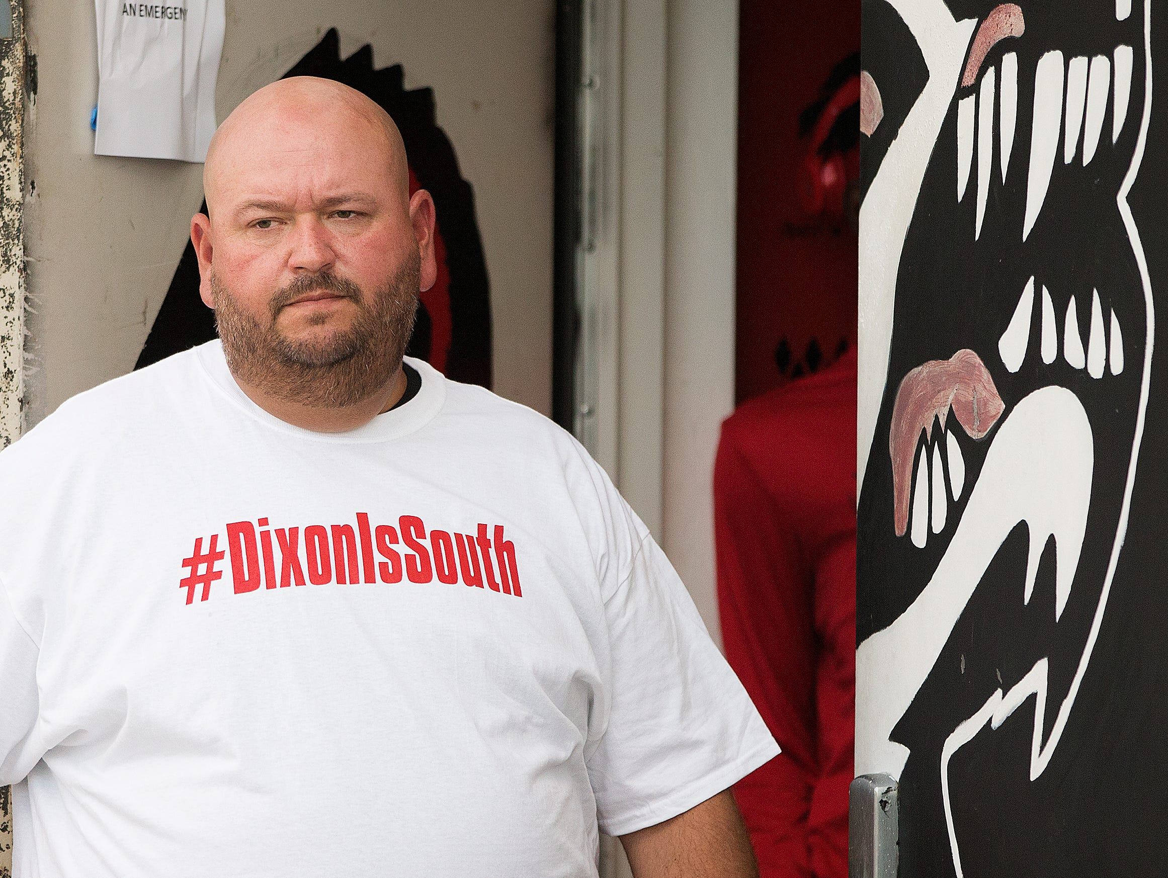 """""""Its been emotional around here,"""" said Matthew Holderfield, South Fort Myers High School's interim head football coach, before Friday's game against Largo at South Fort Myers High School. Holderfield was referring to the team's reaction to the firing of former head coach Anthony Dixon recently. Holderfield, his assistant coaches and fans wore #DixonIsSouth shirts in support of Dixon."""
