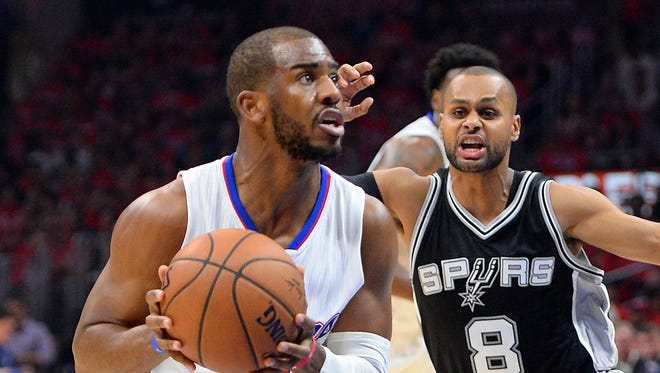 San Antonio Spurs guard Patty Mills (8) guards Los Angeles Clippers guard Chris Paul (3) in the first half of game seven of the first round of the NBA Playoffs at Staples Center.