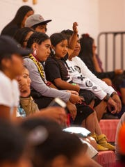 A young girl raises her hand to ask Southern Utah University head football coach Demario Warren a question during the Paiute Restoration Gathering & Pow Wow at the Paiute Tribal Center, Saturday, June 11, 2016.
