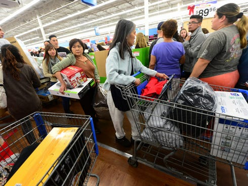 Walmart says it will help more people be assured they will get their Black Friday deals this year. Here, people get an early start on Black Friday shopping deals at a Walmart Superstore in Rosemead, Calif. last year.