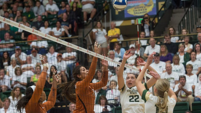 Katie Oleksak and Alexandra Poletto of CSU try to send the ball back to the Texas side of the net during a game at Moby Arena Friday, September 9, 2016.