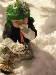 A baby's first snow in Deming.