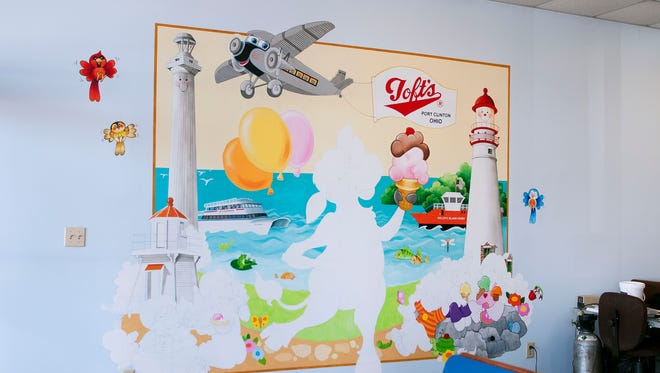 Toft's Ice Cream Parlor in Bassett's Market is getting a scoop of color in the form of a mural drawn and painted by Jodie and Grant McCallum this spring.