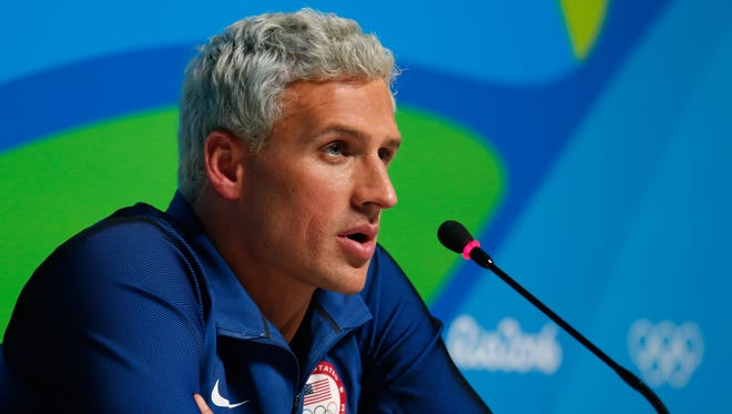 """Ryan Lochte didn't go into details in Friday's apology, but said he and his three teammates faced a """"traumatic"""" situation."""