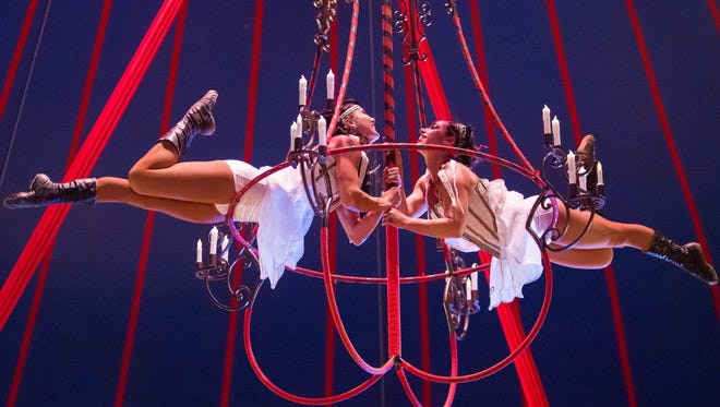 Performers participate in an acrobatic act involving a chandelier in a Cique Ma'Ceo performance. The troupe will be performing 24 times at the Oregon State Fair.