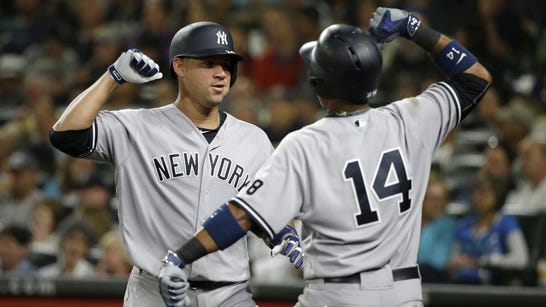 The Yankees' Gary Sanchez, left, greets Starlin Castro