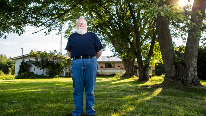 "William ""Butch"" Smith is photographed in his front yard in Pike County, Ohio. Smith is the Democratic candidate who hopes to unseat Republican Rep. Brad Wenstrup in the heavily Republican 2nd Congressional District. The problem: Smith doesn't campaign."