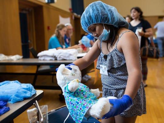 Eight-year-old Bethany Maldonado picks up her bear