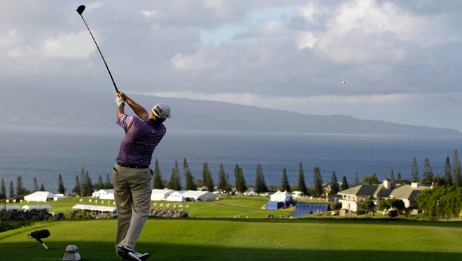 Madison's Steve Stricker hits from the 18th tee at the 2012 Tournament of Champions in Kapalua, Hawaii, which he won.