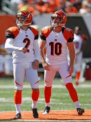 Bengals kicker Mike Nugent (2) and punter/holder Kevin Huber watch one of Nugent's field-goal attempts against the Falcons.