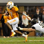 Tennessee's Cameron Sutton (7) escapes from Vanderbilt linebacker Bradyn Jasper (56) and runs 89 yards for a touchdown on a punt return  on Nov. 28, 2015, in Knoxville.