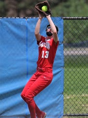 Going back to make a catch is Canton outfielder Kathleen Brady (13).