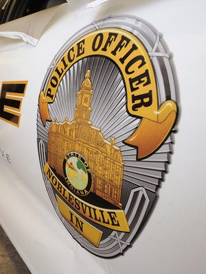 A vinyl decal is displayed on a Noblesville Police cruiser.