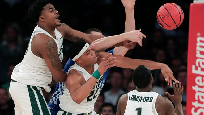 Michigan State freshmen Nick Ward, left, Miles Bridges, center, and Joshua Langford vie for a rebound against Kentucky forward Isaac Humphries, rear, during the first half of Tuesday night at Madison Square Garden.