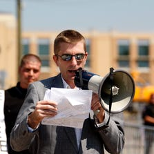 Robert Ransdell of the National Alliance, identified by the Anti-Defamation League as a white supremacist group, leads a rally near North College Hill in 2012. He now says he is a write-in candidate in the Kentucky Senate race.