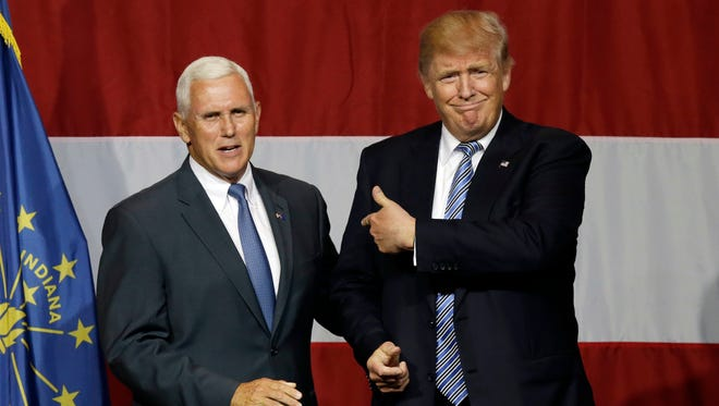 Indiana Gov. Mike Pence joins Republican presidential candidate Donald Trump at a rally July 12, 2016, in Westfield, Ind.