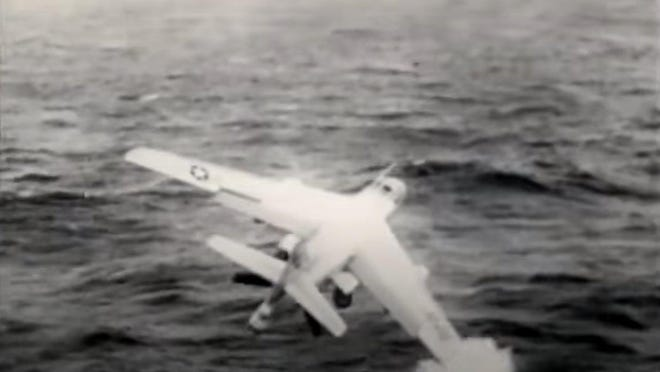 Navy Cmdr. Charles Frohne plane is captured in this video image from footage taken from the crash off USS Saratoga aircraft carrier that took his life and two others 60 years ago. His son lives in Atlantic Beach.
