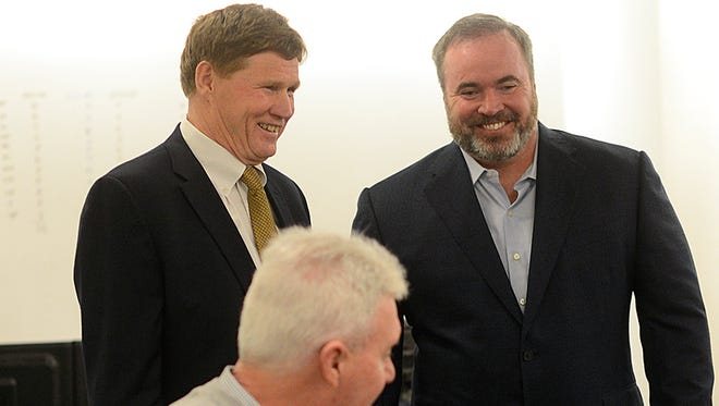 Green Bay Packers general manager Ted Thompson, head coach Mike McCarthy and president Mark Murphy share a smile as they visit with each other inside the war room during an NFL Draft.