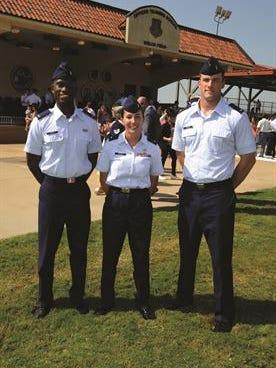 Second lieutenants, from left to right, David Smith, Courtney Tremer and Drew Tatum, celebrate after graduating from OTS on Sept. 2. Smith and Tatum are slated to become pilots and Tremer a logistics officer.