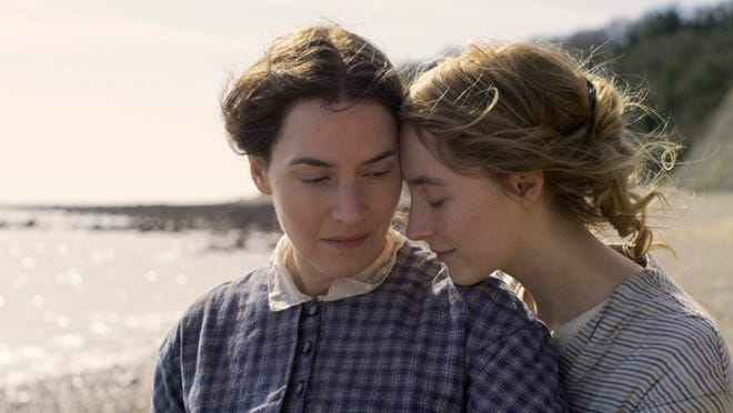 """Kate Winslet, left, and Saoirse Ronan in a scene from """"Ammonite."""""""