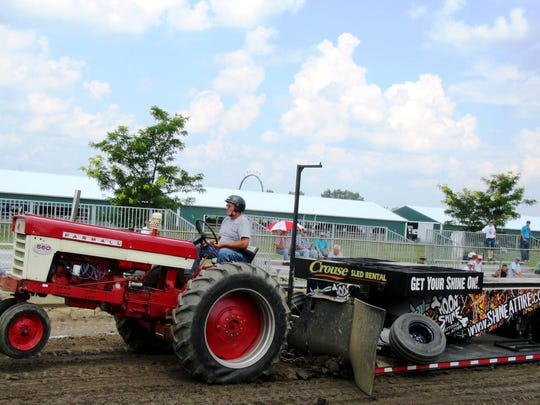 With its front wheels off the ground, this farm tractor heads down the track in the pulling contest at the 2015 Hunterdon County 4-H and Agricultural Fair.