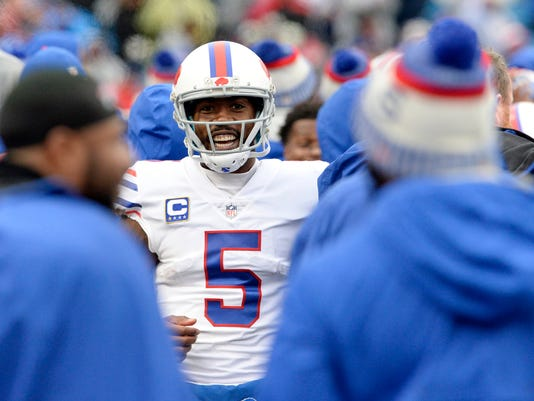 Buffalo Bills quarterback Tyrod Taylor reacts after teammate LeSean McCoy scored on a long touchdown run during the second half of an NFL football game against the Oakland Raiders, Sunday, Oct. 29, 2017, in Orchard Park, N.J. (AP Photo/Adrian Kraus)