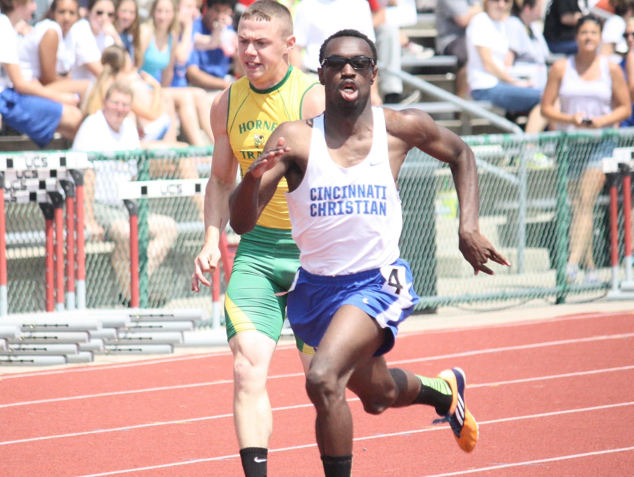 Cincinnati Christian's Kameron Antwine wins the second heat of the 200 meters at the Division III state meet.