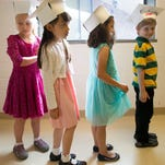 Horn Elementary kindergarteners line up for their graduation ceremony on Tuesday, June 2, 2015.