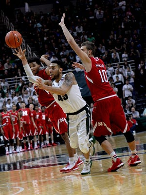 Denzel Valentine splits two Nebraska defenders and hits a three pointer with four seconds left in the second half to pull the Spartans within one of Nebraska. MSU would lose the game 72-71  Wednesday, Jan. 20, 2016, at the Breslin Center in East Lansing. The loss drops MSU to 16-4, 3-4 in the Big Ten.