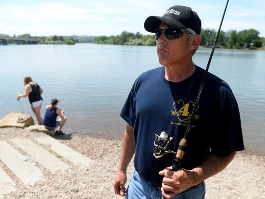 Dave Belcher loves to fish with his wife, Michelle,