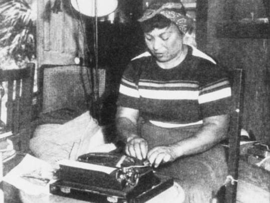 In what may be one of the only photos of Zora Neale Hurston in Brevard County, the late author types