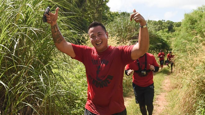 In this file photo, Team Fache' Daggan's Matthew Quitugua shares a smile during the KONQER Obstacle run