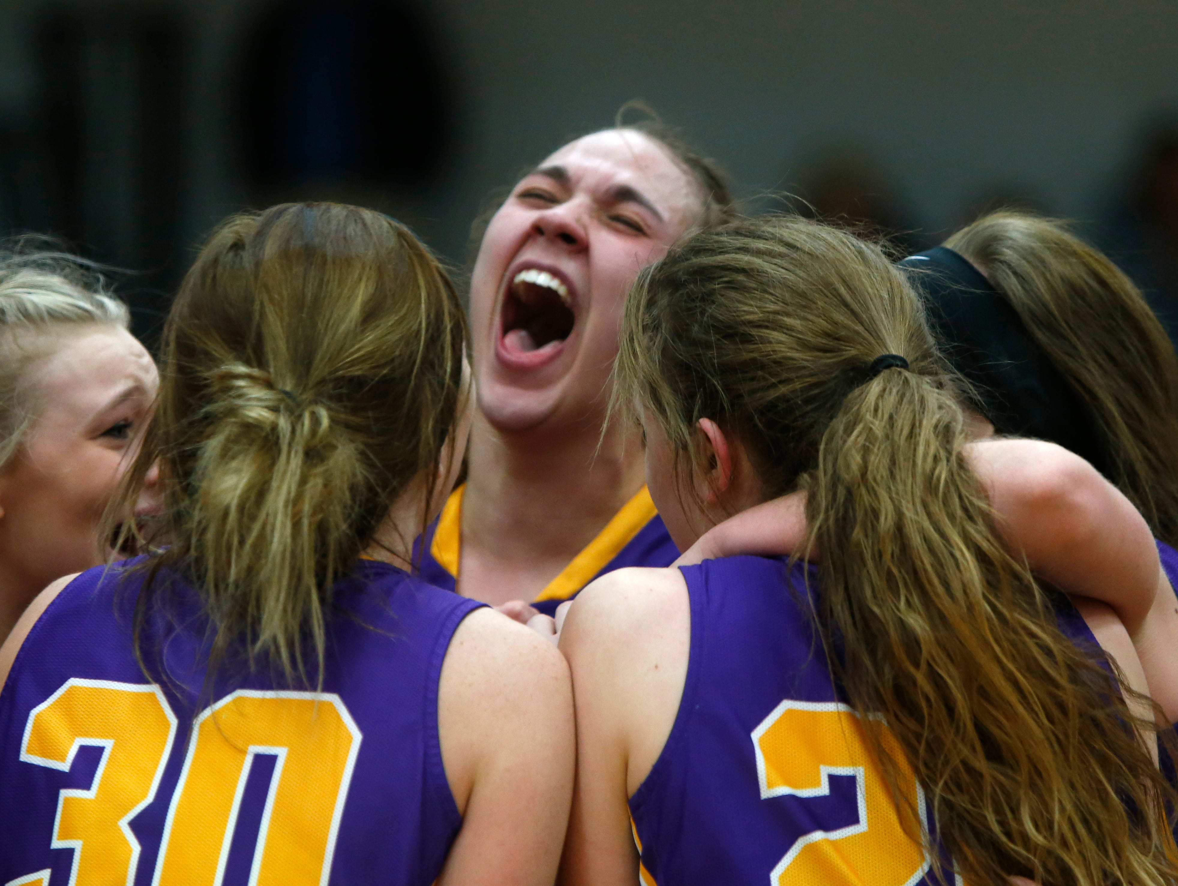 Eastern-Pekin players celebrated after their victory over providence in the Indiana girls sectional final. Jan. 4, 20167.