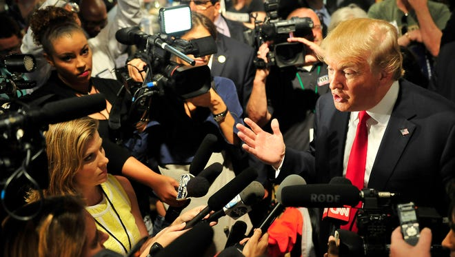 Republican presidential candidate Donald Trump talks with the media after speaking at the event for the National Federation of Republican Assemblies at Rocketown in Nashville on Saturday, Aug. 29, 2015.