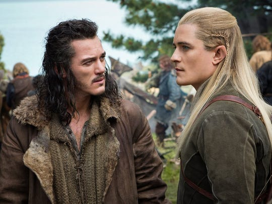 """Orlando Bloom and Luke Evans in a scene from """"The Hobbit: The Battle of Five Armies."""""""