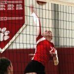 Beechwood junior Liz Pawsat goes for the kill Sept. 24, 2014.