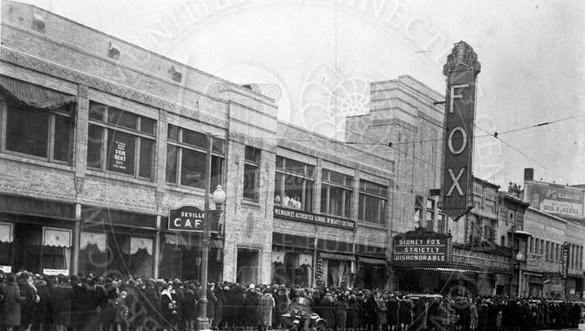 Crowds gather outside of the Fox Theatre on Washington Street in 1931. Since its opening in 1930 as one of seven vaudeville and movie houses in the area, the Fox underwent several changes, including a bankruptcy in 1933 that led to the theater's operation under the new name, the Bay. It was later converted into a movie multiplex.