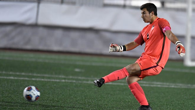 Castle goalkeeper Michael Bertram clears a ball in the Class 3A state championship match last October at Michael A. Carroll Stadium in Indianapolis. The rising senior suffered a knee injury during a summer scrimmage last week.