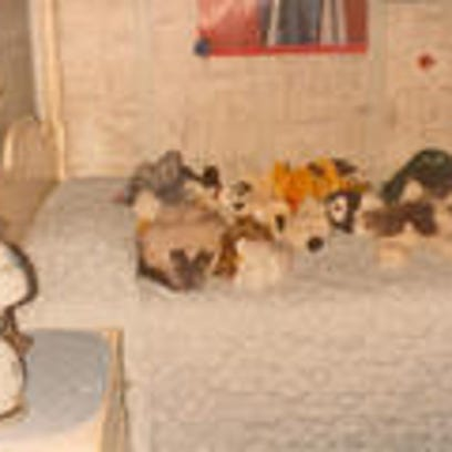 Maureen's childhood bed, loaded with stuffed animals