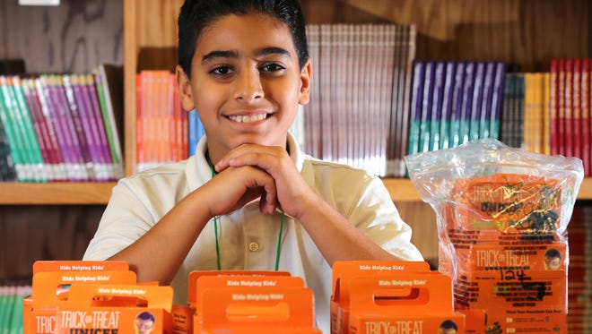 Elias Al Salhy, 11, is shown with some of the money collected by his school for UNICEF. The boy attends Victory K-8 and Milwaukee Italian Immersion School in Milwaukee. He worked hard and raised more than any other student at the school.