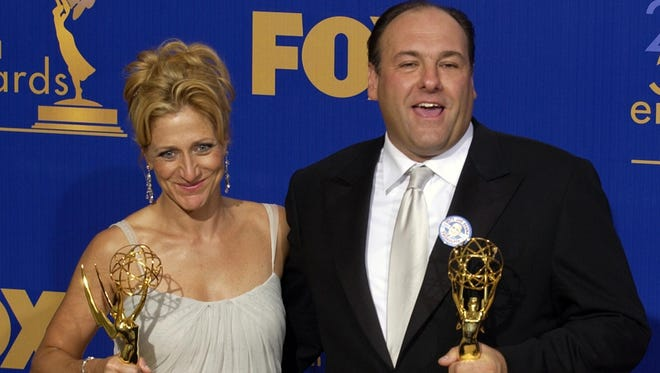 """Edie Falco and James Gandolfini with the Emmy Awards they received Sept. 21, 2003, for outstanding lead actress and actor in a drama series for their work on HBO's """"The Sopranos."""""""