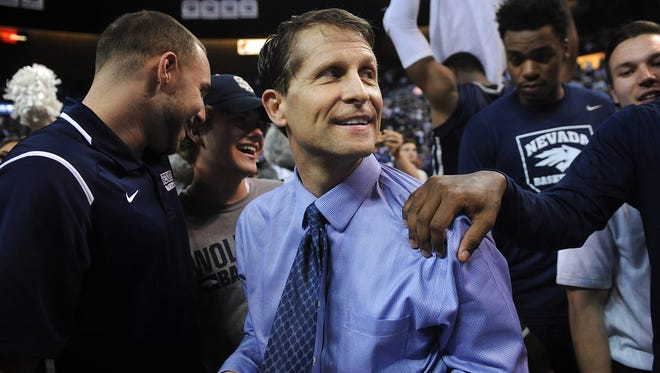 Coach Eric Musselman celebrates after Nevada defeated Morehead State to win the College Basketball Invitational.