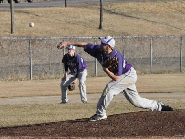 Albany senior pitcher Shane Olmscheid delivers in a game earlier this season.