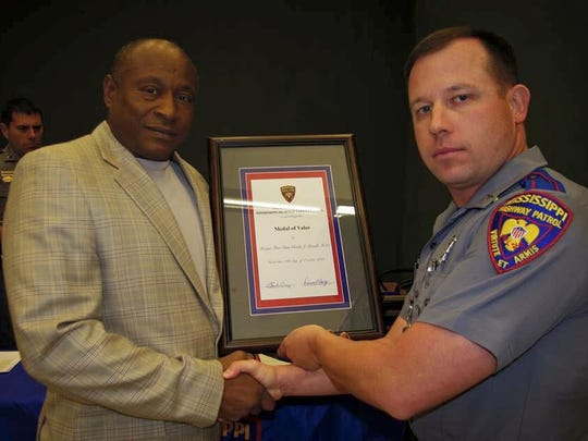 Trooper Jason Powell receives the Medal of Valor award in 2010