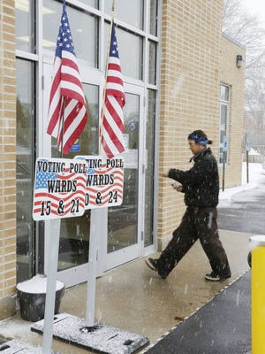 A voter enters the Senior Activity Center, polling place for wards 15,20, 21 and 24 Tuesday February 16, 2016 in Sheboygan.