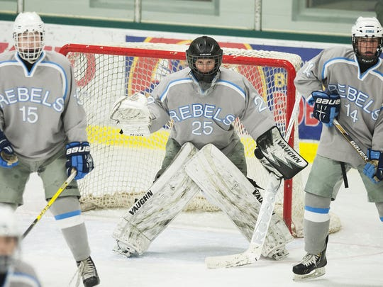 South Burlington goalie Zach Munson (25) keeps his eye on the puck during the boys hockey game between the Champlain Valley Union Redhawks and the South Burlington Rebels at Leddy Ice Rink on Thursday afternoon.