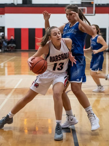 Marshall's Abby Welke (13) drives to the hoop during
