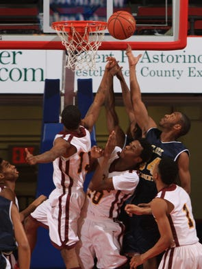 Clark's Clayvon Buckner (34) wins a rebound against Biondi during the Class D boys basketball championship game at the Westchester County Center in White Plains Feb. 28, 2014. Clark won the game 49-34.