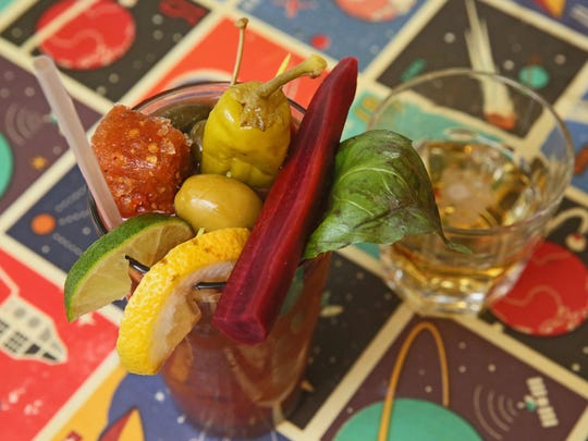 Among the garnishes on the Bloody Mary at Sabrosa Cafe is a frozen cube of tomato juice and spices.